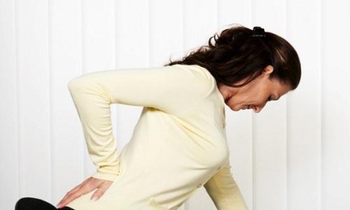 Боль в почках у женщины